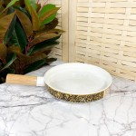Ceramic bowl with wooden handle