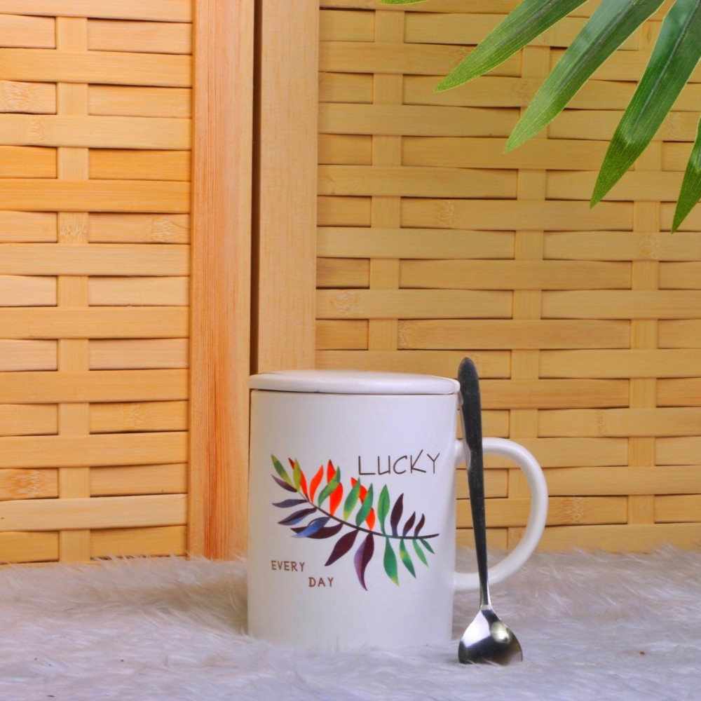 Ceramic cup with spoon